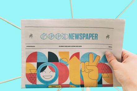 hand holding a newspaper