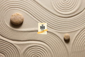 Image of Zen garden with swirling sand patterns around rocks.  This image represents a free online course on Mindfulness for Wellbeing and Peak Performance., including Class Central badge for Top 100 Course of All-Time