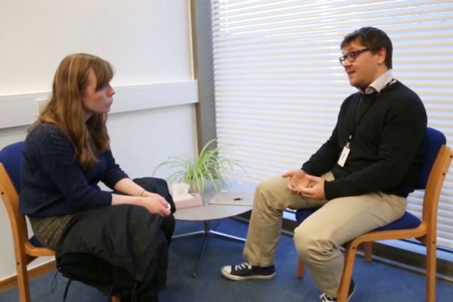 Dr Jon Roberts in a genetic counselling session with a young adult, female patient, discussing the result of her screening for Huntington's disease