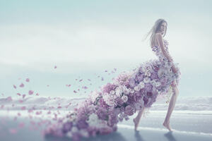Woman wearing a dress made of flowers