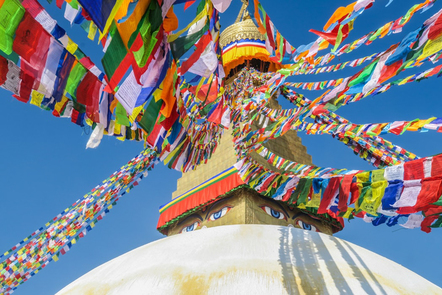 Colourful prayer flags hanging across a blue sky