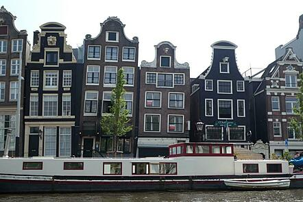 Image of houses in Amsterdam and a canal boat