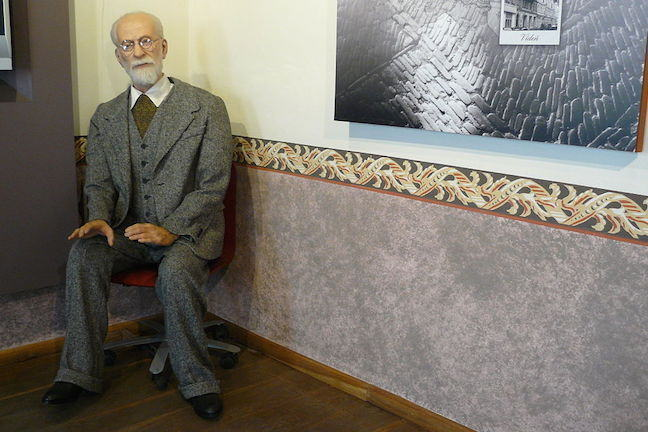 Figure of Sigmund Freud sitting in the corner of a room