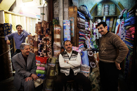 Traders relax in front of their stalls in the al-Hamidiyeh souk in Damascus.