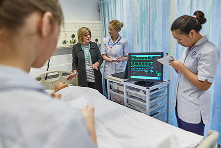 Nurses in a hospital ward having a discussion