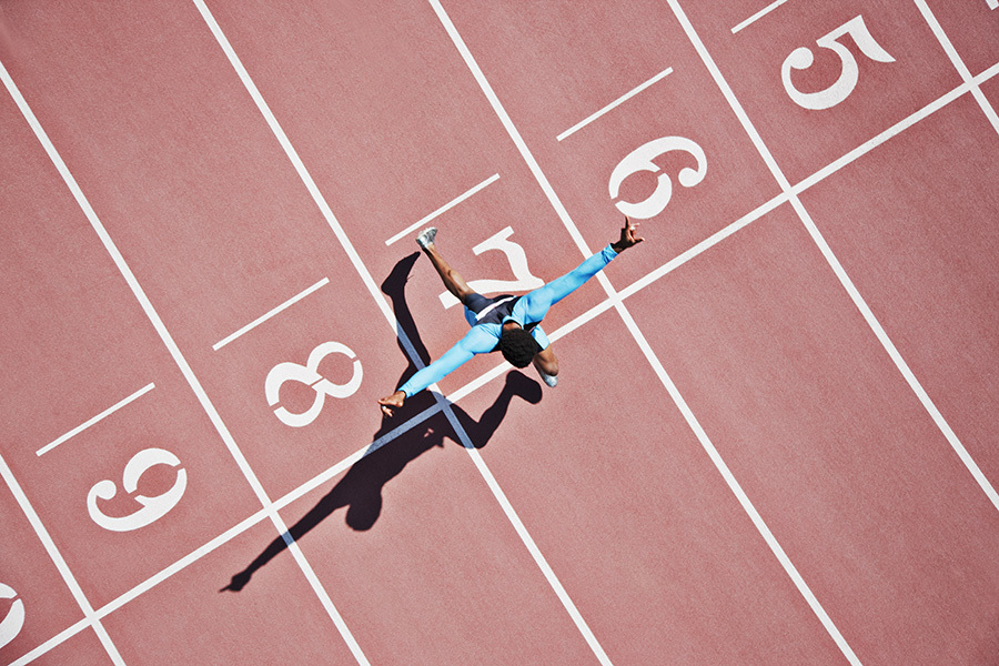Athlete running across start line - birds eye view