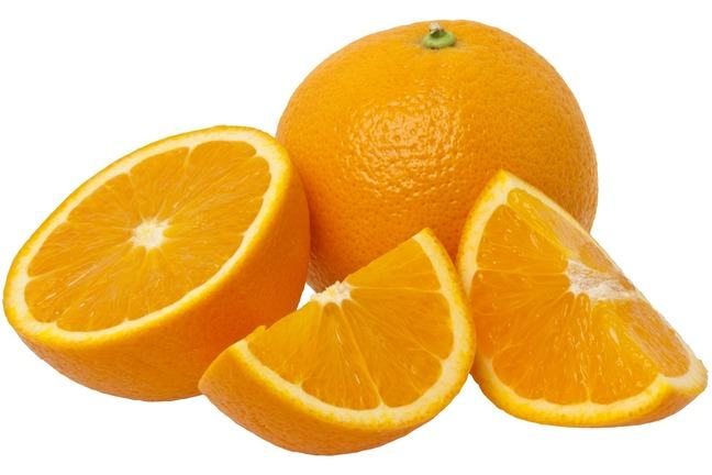 A photo of two oranges with the one in front split into a half and two quarters.  The split orange's flesh is facing forwards.