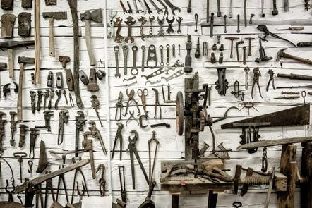 Lots of tools hanging on a wall