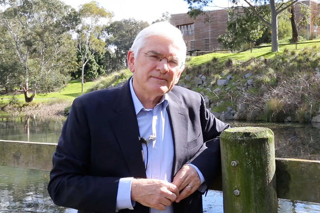 Rob Skinner standing near a lake.