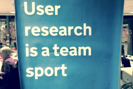 a banner with 'user research is a team sport' written on it