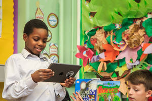 Child reading an ipad