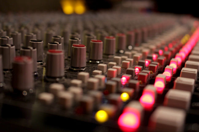 A mixing desk all lit up