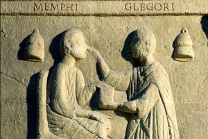 An ancient stone carving depicting a doctor treating a patient