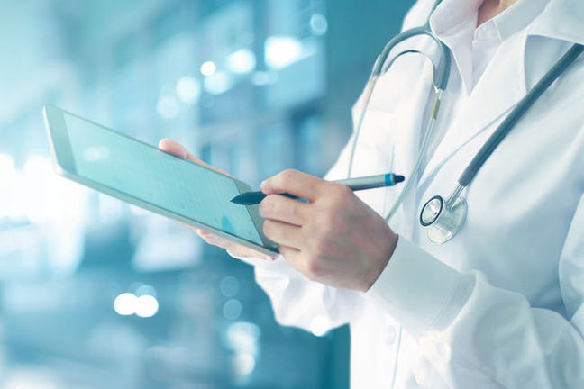 Healthcare professional using mobile device.