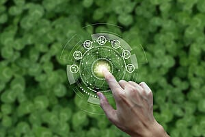 An image of a circular business model overlaid on a field of clover