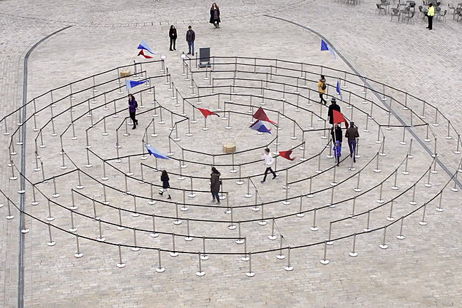Outdoor game with people walking in a circular space