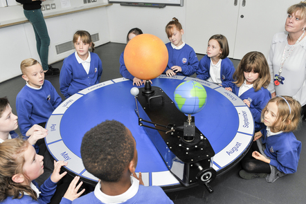 Childeren interacting with an astronomer