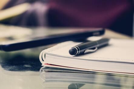 pen on notebook on desk