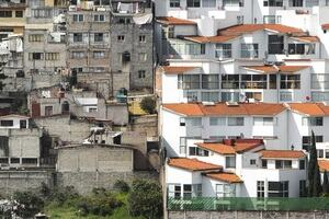 Socioeconomically disadvantaged housing juxtaposed against luxury accommodation