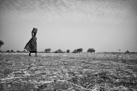 Women and children collect water at Wengoth village in Pariang County in Unity State, South Sudan.