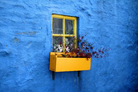 Vibrant blue cottage with yellow window box in Kinsale, Co. Cork