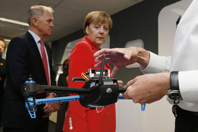 Germany's Chancellor Angela Merkel looking at a drone prototype.