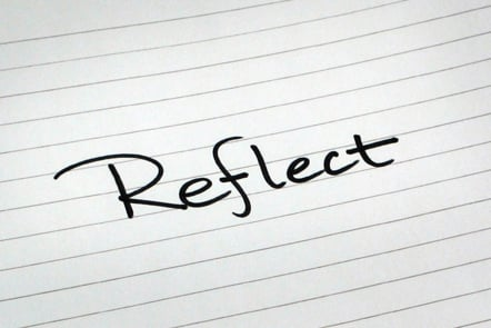 A page with the word 'Reflect' written down.