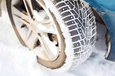 A car wheel covered in snow
