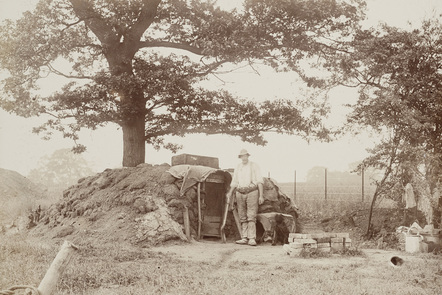 A Navvy outside the small earth shelter on the Harrow and Uxbridge Line c1904. Some would have had to sleep in conditions like this during construction.