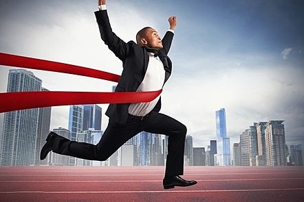 Success of a businessman at a finishing line.