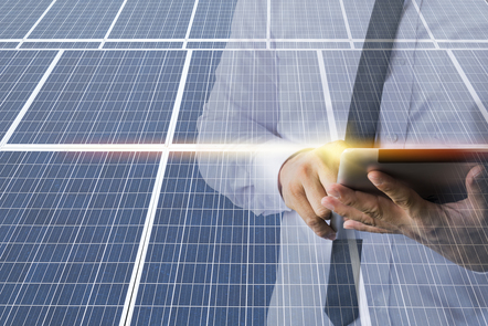 Business man calculating an investment on solar panels
