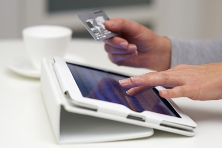 Man making a transaction via credit card on a tablet device