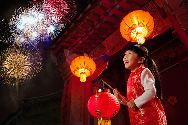Girl on stage with Chinese lanterns