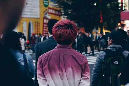 Man with pink hair and shirt in Tokyo