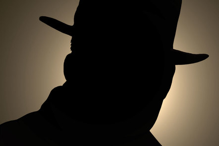 Silhouette of a man wearing a hat