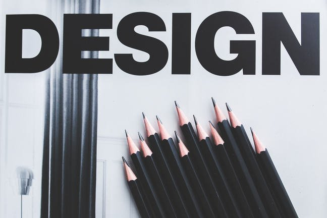 titled Design, with lots of sharp black pencils of differing lengths