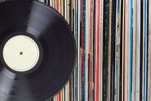 A vinyl record and a collection of record sleeves
