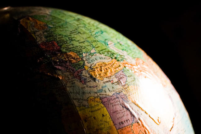 close up of globe, with dark background