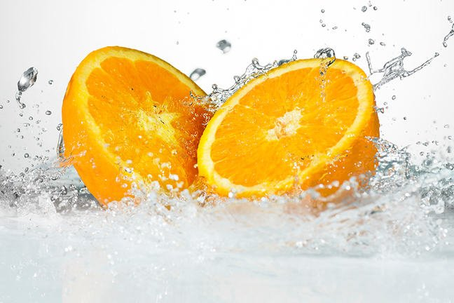 Orange cut in half water splash