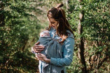 Woman standing in nature with baby