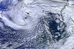 Weather: a satellite image of clouds above the earth