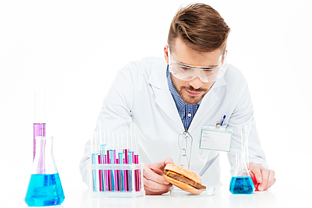 Male chemist holding food in lab