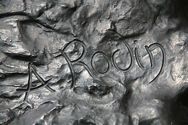 A cropped photograph of Auguste Rodin's signature in ink