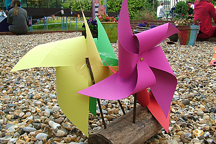Bright paper windmills at an end of term fete