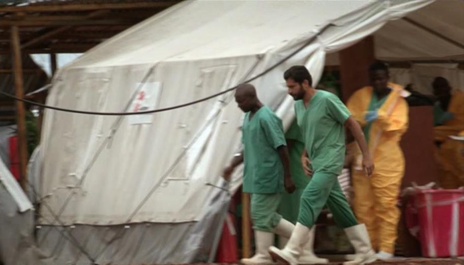 Medics moving between tents