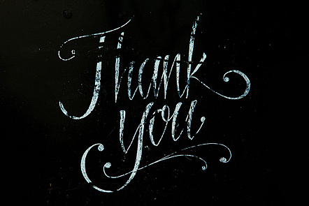 Hand-written thank you sign © Donald Giannatti, Unsplash