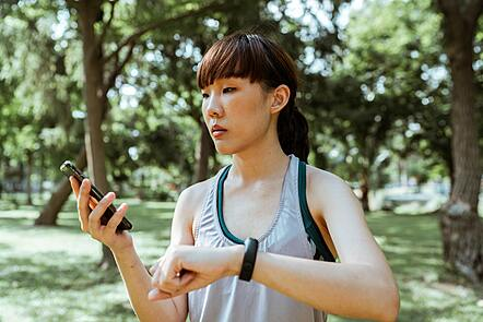 a woman checking her fitbit