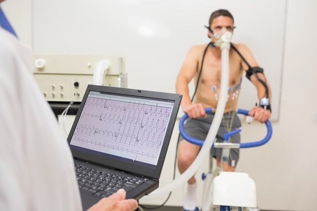 Male athlete on a sports science bicycle doing testing.