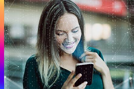 Photo of woman using phone for biometric verification