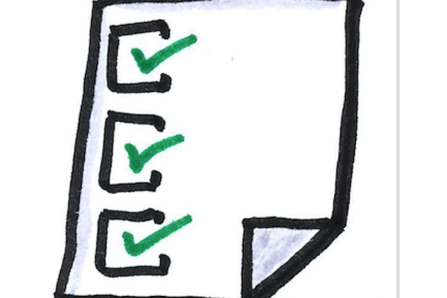 White paper with green ticks on a checklist